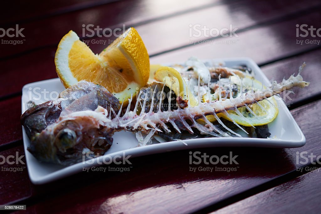 bream leftovers in plate stock photo