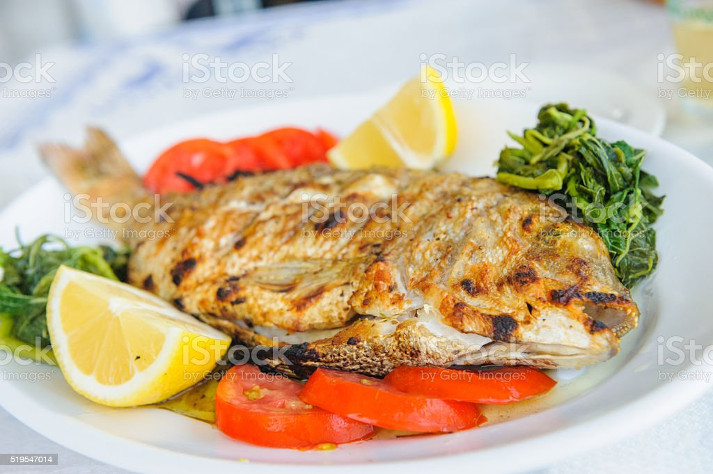 Bream on grill with vegetables stock photo