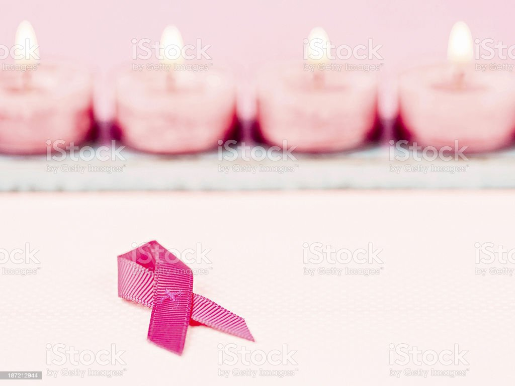 Breast Cancer Awareness Ribbon and Pink Candles royalty-free stock photo