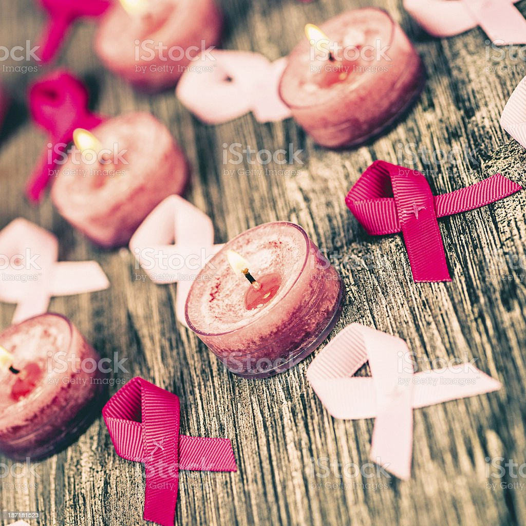 Breast Cancer Awareness Ribbons and Pink Candles royalty-free stock photo