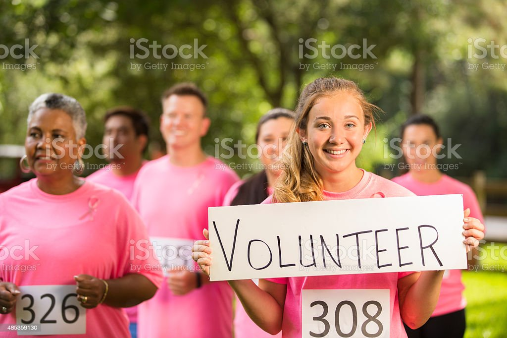 Breast Cancer Awareness volunteers run charity race. stock photo
