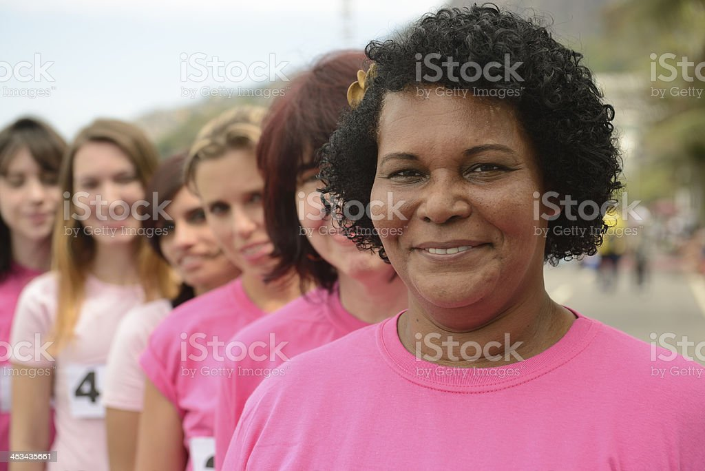 Breast cancer charity race, woman in pink. stock photo