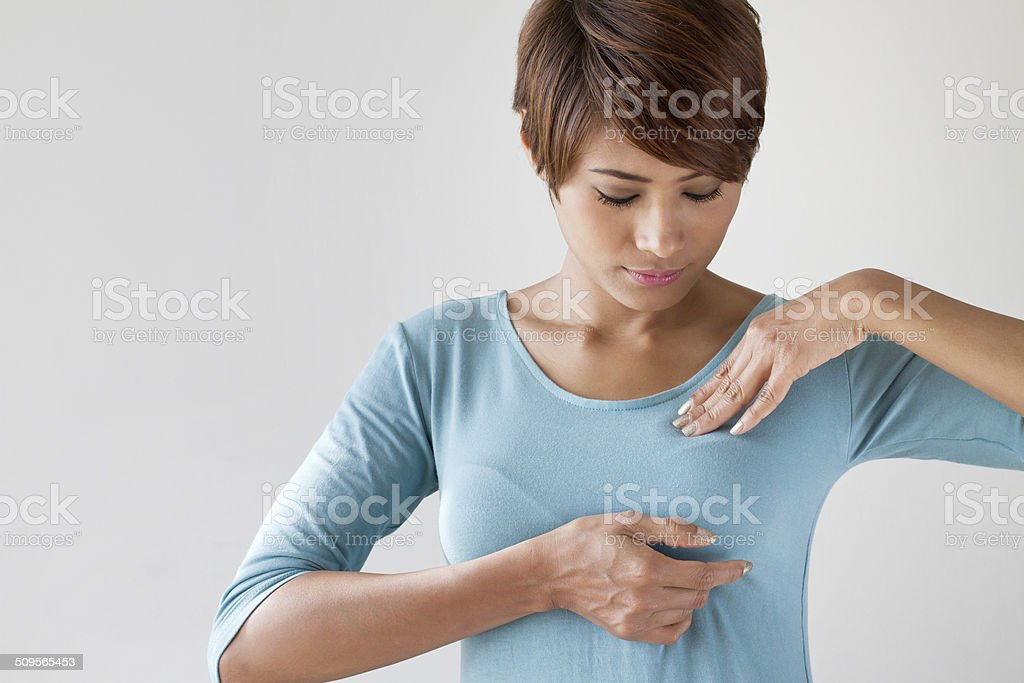Breast cancer self check, healthy lifestyle concept stock photo