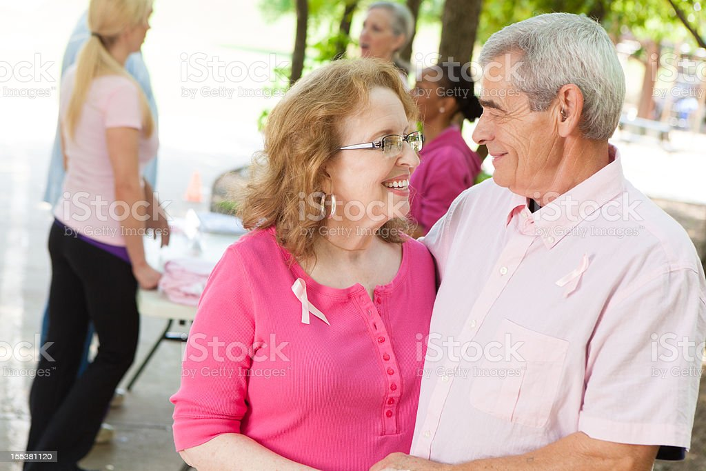 Breast cancer survivor and supportive husband at charity awareness race royalty-free stock photo