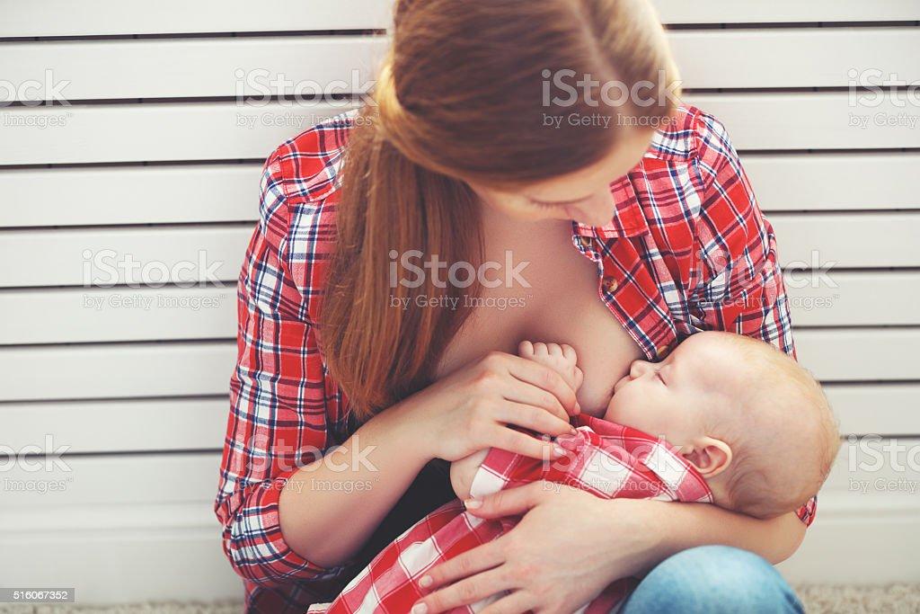 breastfeeding. mother breast feeding baby stock photo