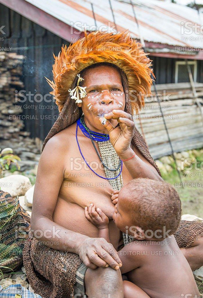 breastfeeding mother smoking a cigarette stock photo