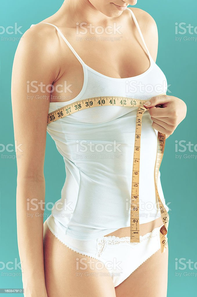 Breasts measuring royalty-free stock photo
