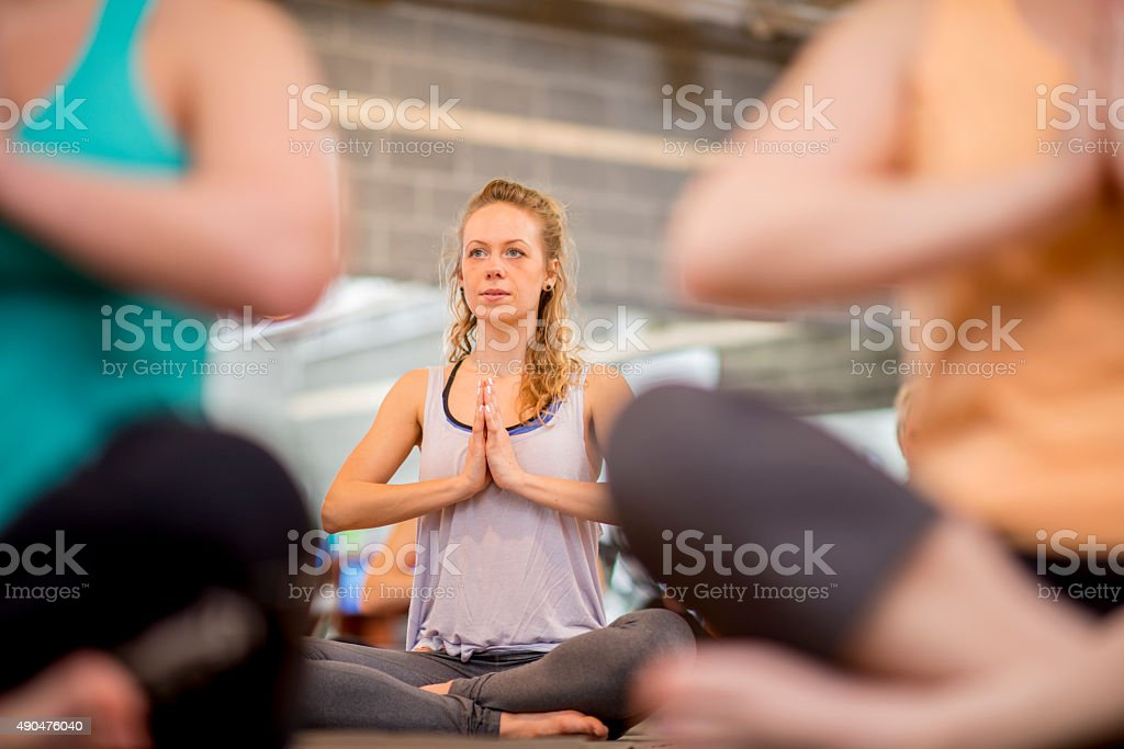 Breathing Exercises in Yoga Class stock photo