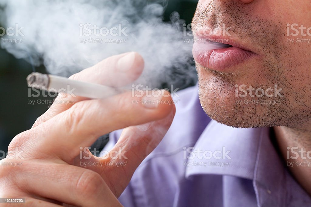 Breathing smoke out stock photo