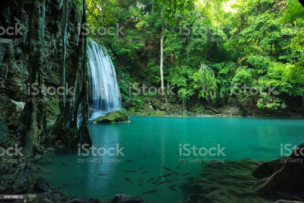 Breathtaking Green waterfall in deep forest, Erawan waterfall stock photo