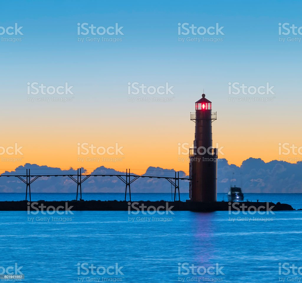 Breathtaking predawn harbor and lighthouse stock photo