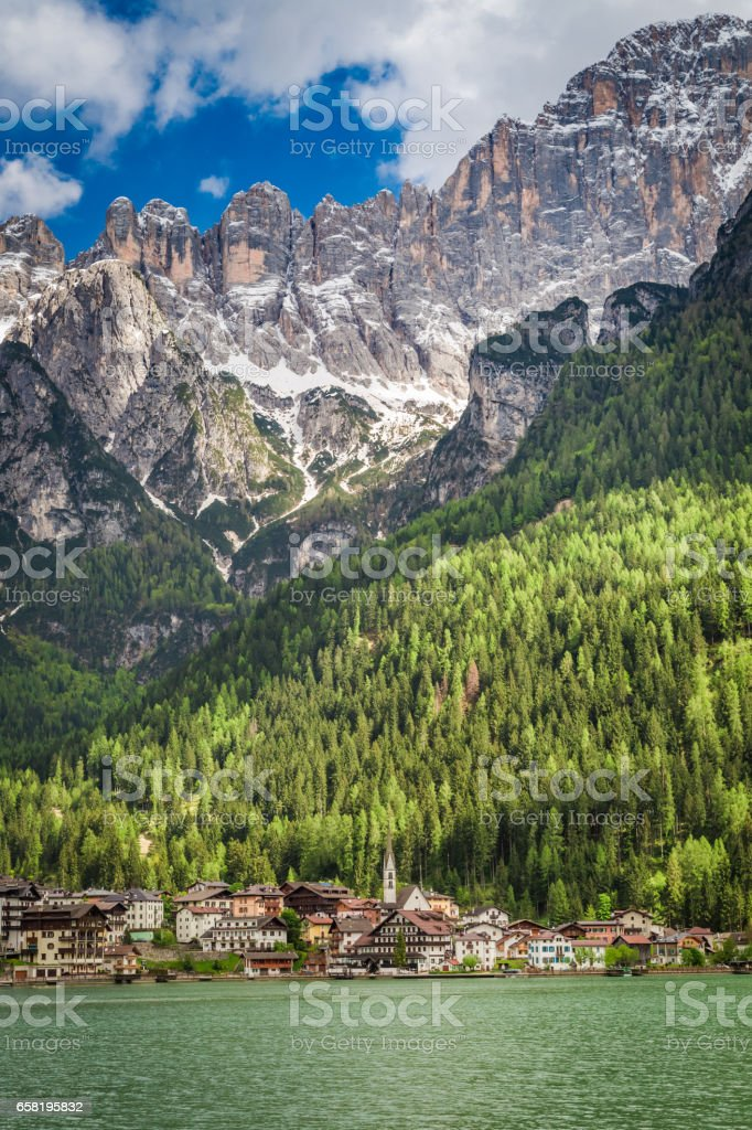 Breathtaking small town by the lake in Dolomites, Europe stock photo