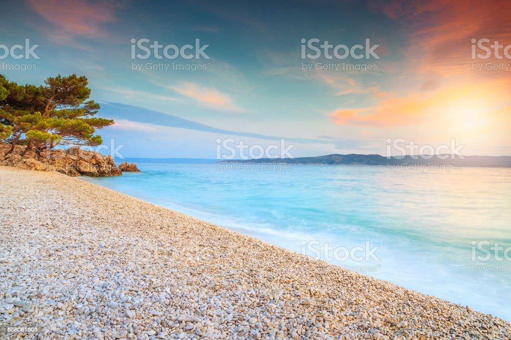 Breathtaking sunset over the sea, near Makarska, Brela, Dalmatia, Croatia stock photo
