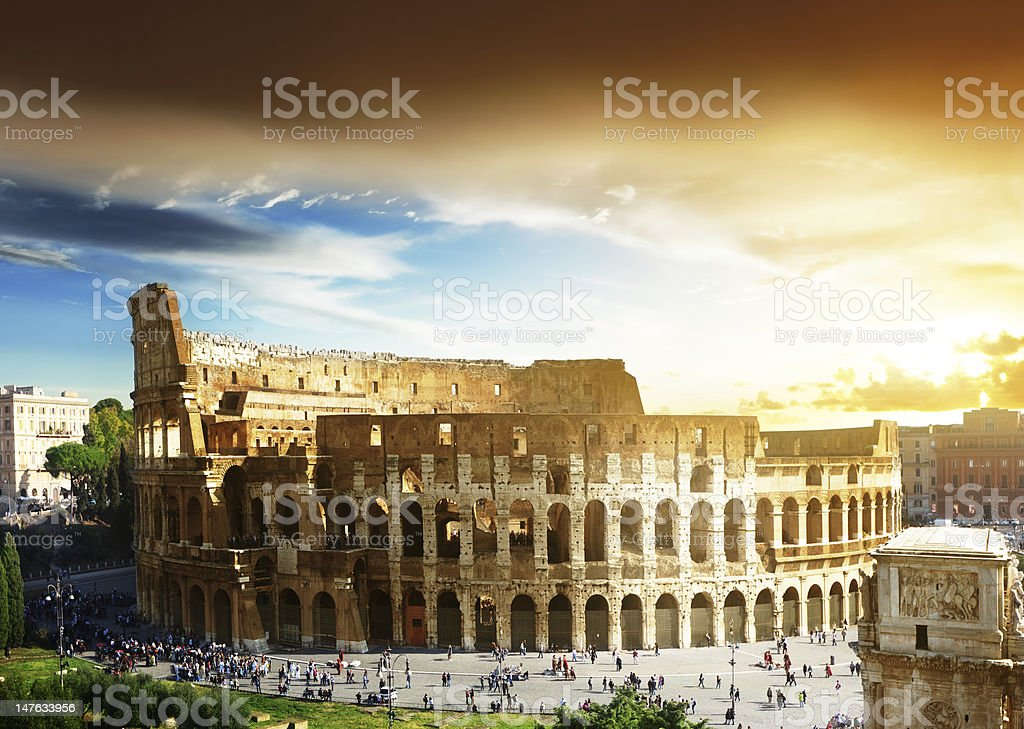Breathtaking view of sun rising at Roman Colosseum in Italy stock photo