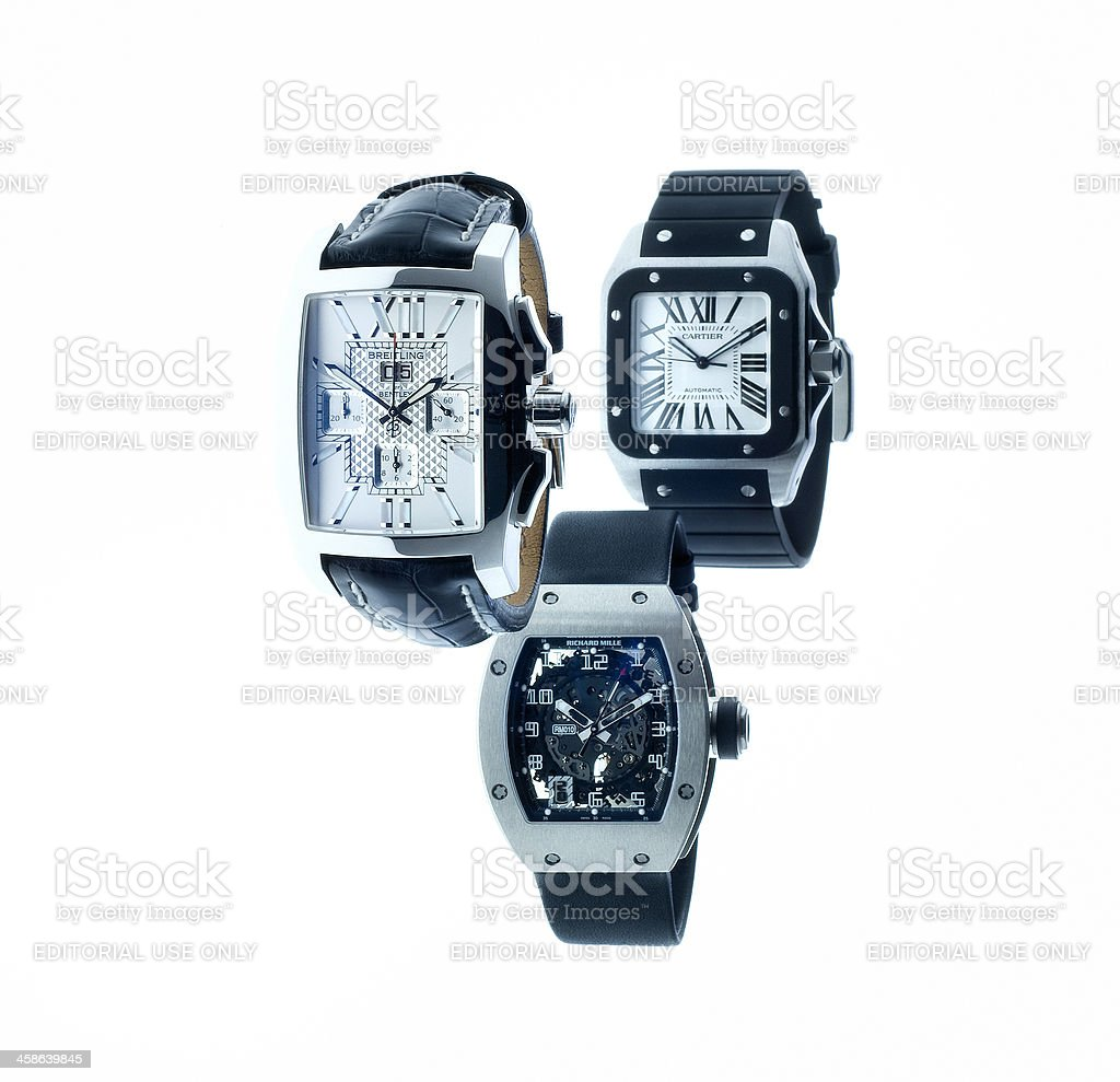 Breitling Bentley, Cartier Santos 100 and Richard Mille wristwatches stock photo