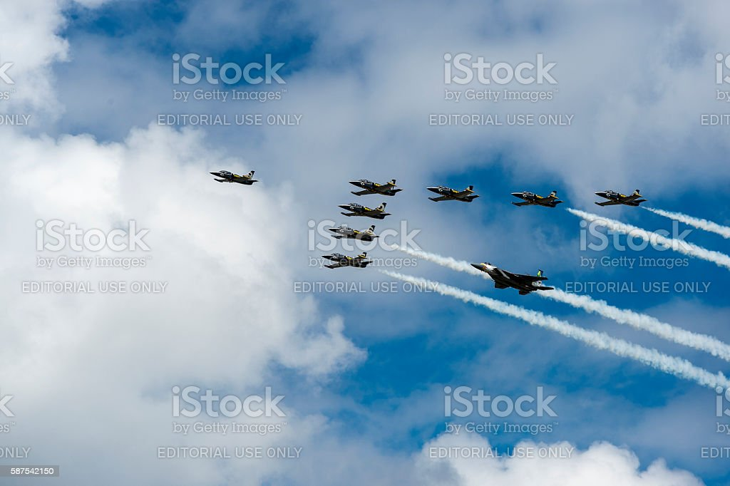 Breitling Jet Team Flying plus OANG F-15C Screaming Eagle Formation stock photo