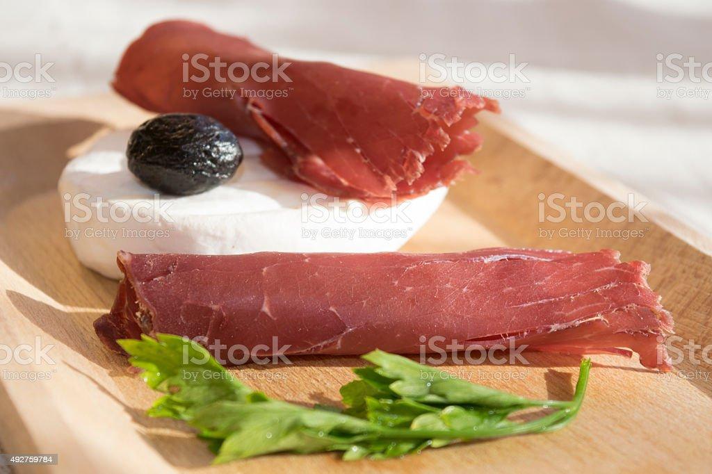 bresaola and tomino stock photo