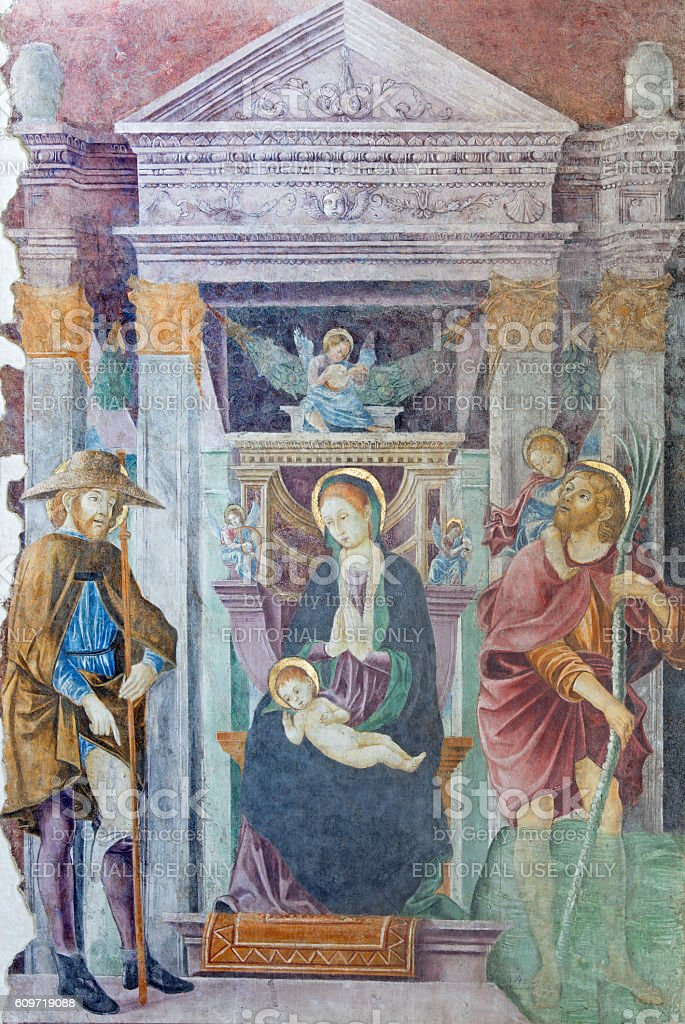 Brescia - Madonna with the St. Christopher and St. Roch stock photo