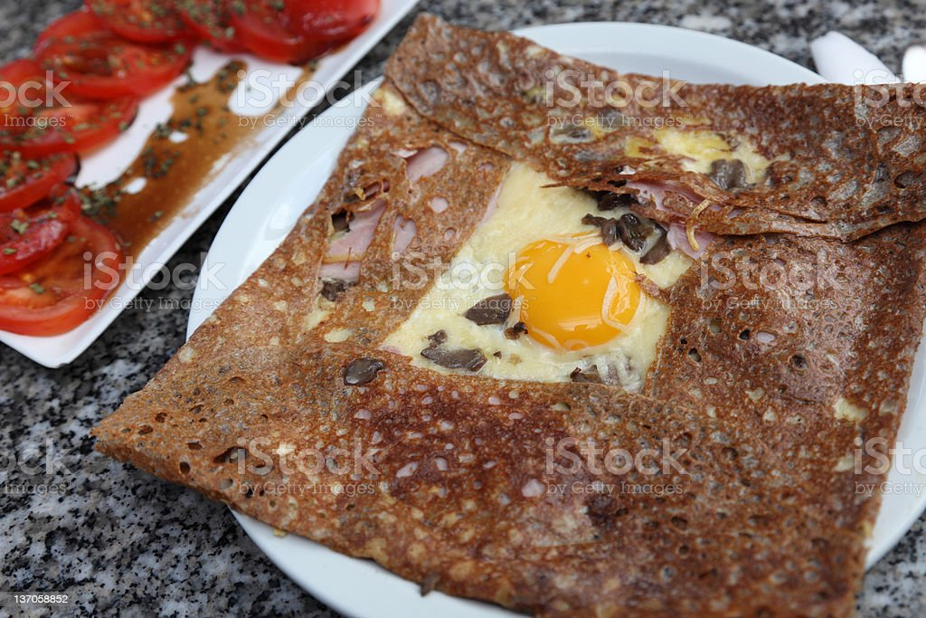 Breton galette and other colorful foods cooked together. stock photo