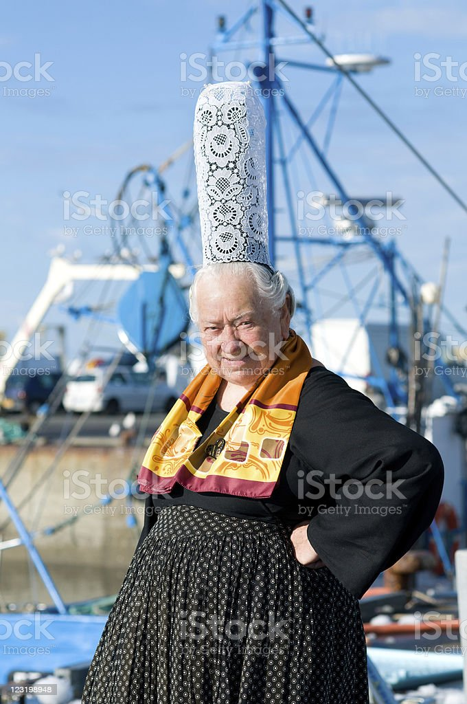 Breton headdress with boats in the background stock photo