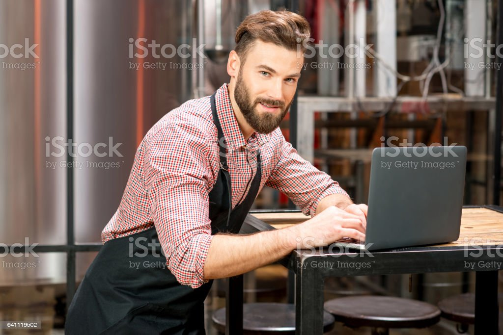 Brewer at the beer manufacturing stock photo