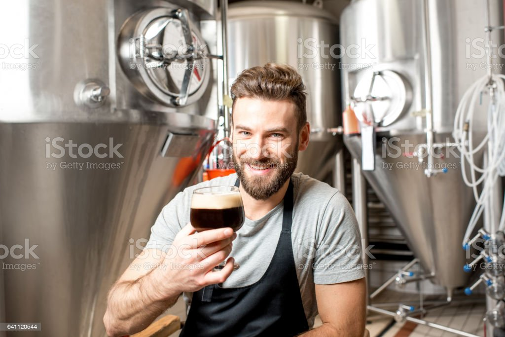 Brewer at the manufacture stock photo