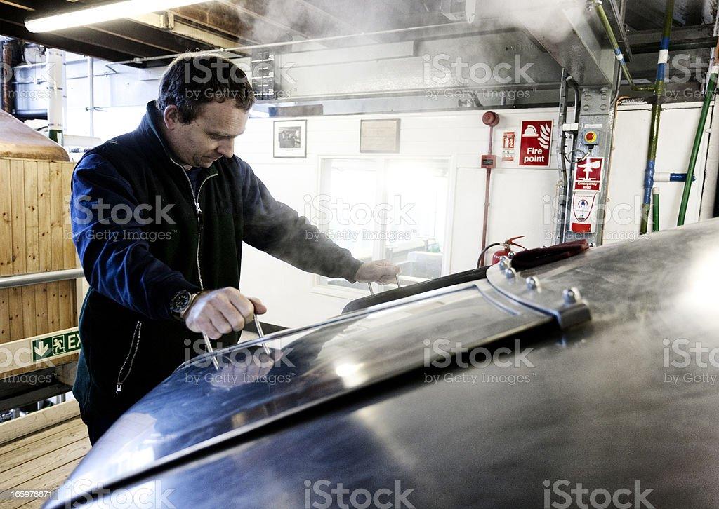 Brewery employee, mash tun and dissolving vat stock photo