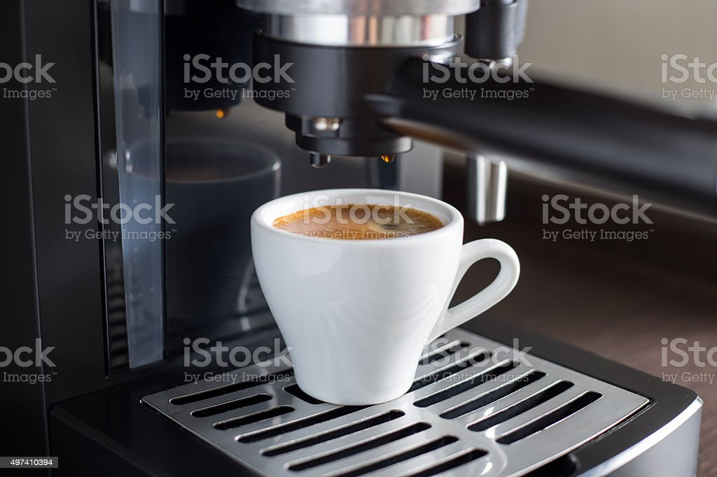 Brewing tasty espresso with coffee machine. stock photo