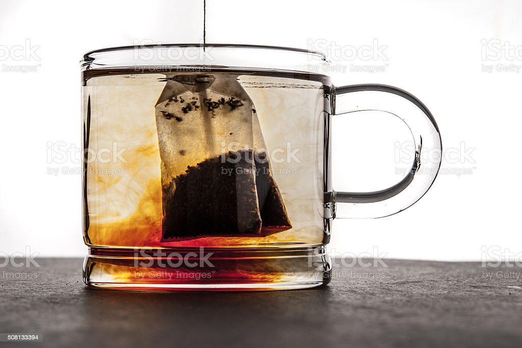 Brewing tea in the transparent cup stock photo
