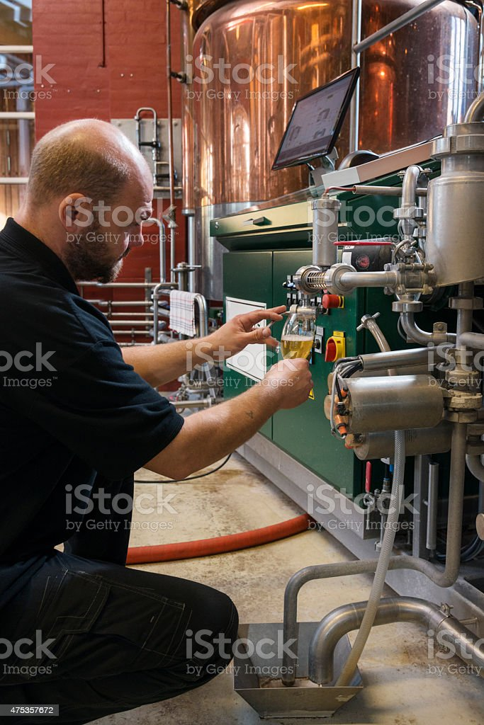 Brewmaster At Work Checking His Brew stock photo