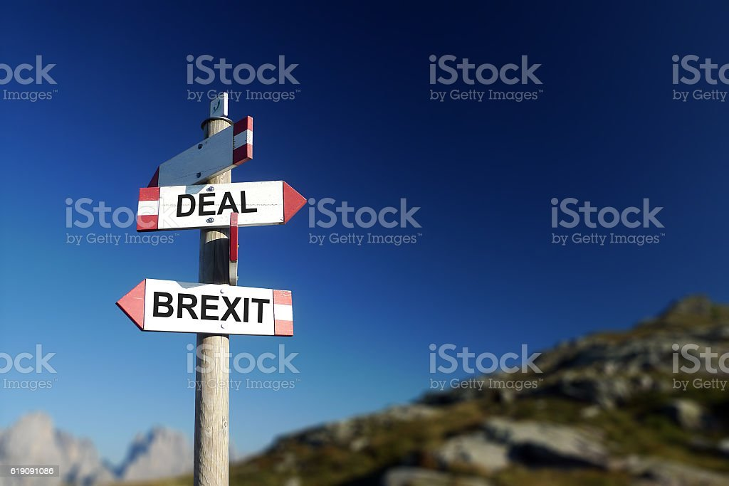 Brexit deal written on mountain road sign. stock photo
