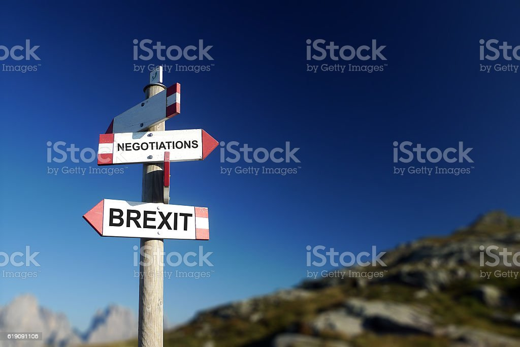 Brexit negotiations written on mountain road sign. Hard Brexit c stock photo