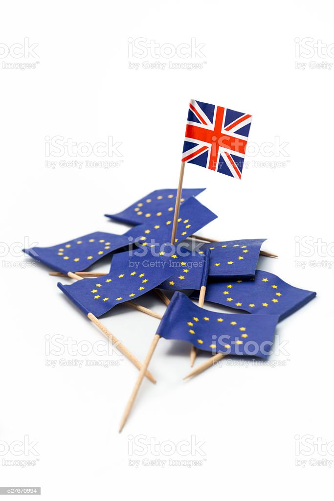 'Brexit' referendum: Union Flag standing on heap EU Flags stock photo