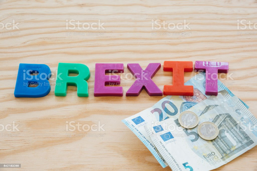 Brexit text and euro money set stock photo