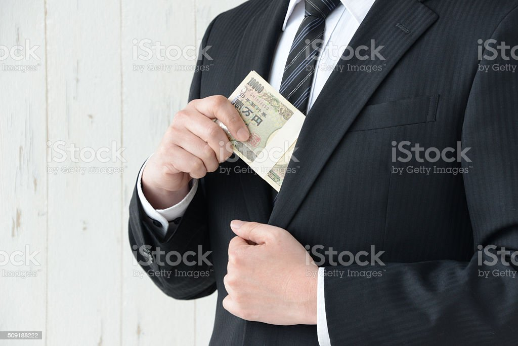 Bribe with Japanese money stock photo
