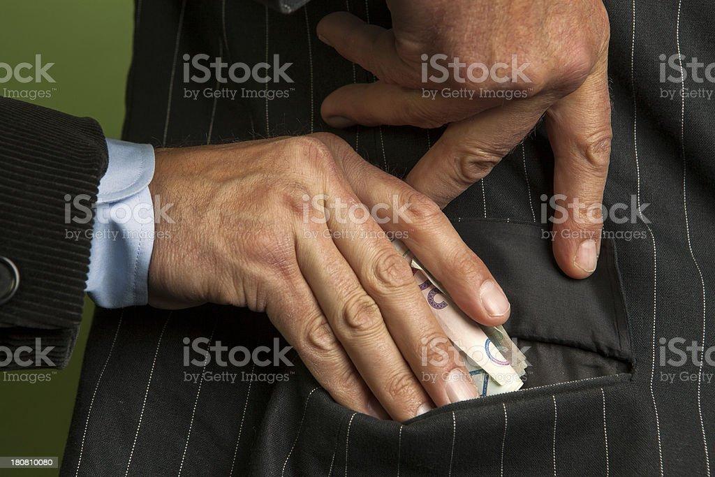 Briber to the pocket royalty-free stock photo