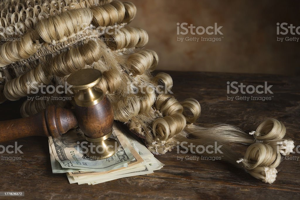 Bribery and corruption in court royalty-free stock photo