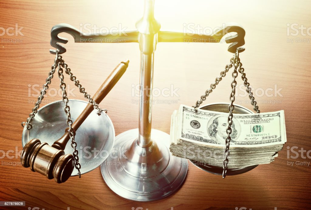 Bribery and corruption: Scales of justice with money stock photo