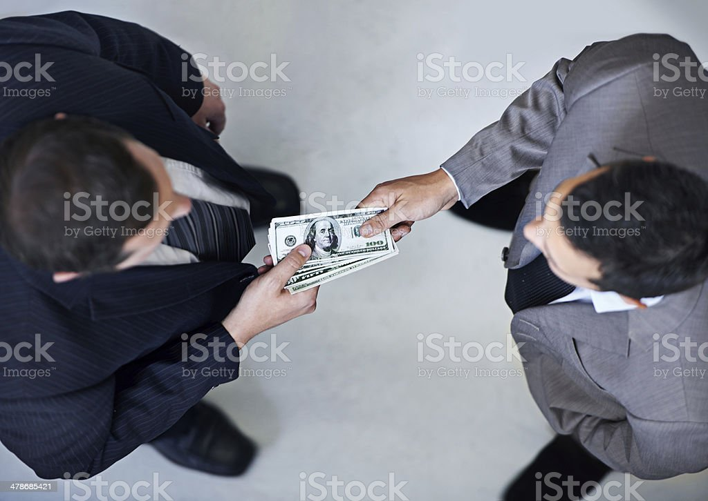 Bribery in the workplace stock photo