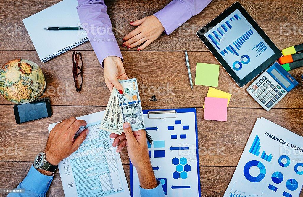 Bribing public servants and avoiding taxation stock photo