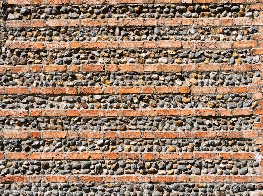 Brick and flint ornamental wall in Suffolk stock photo