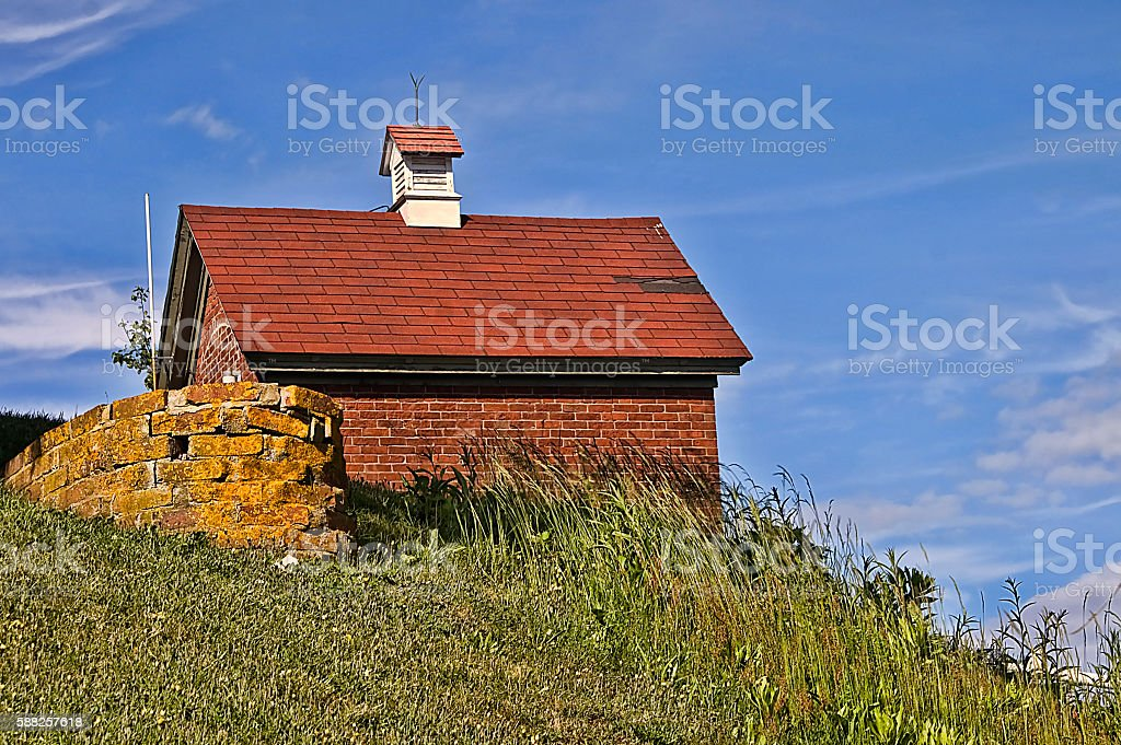 Brick Building on a Hill on a Sunny Day stock photo