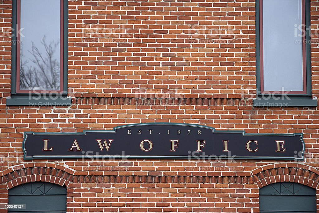 Brick building with a law office sign stock photo