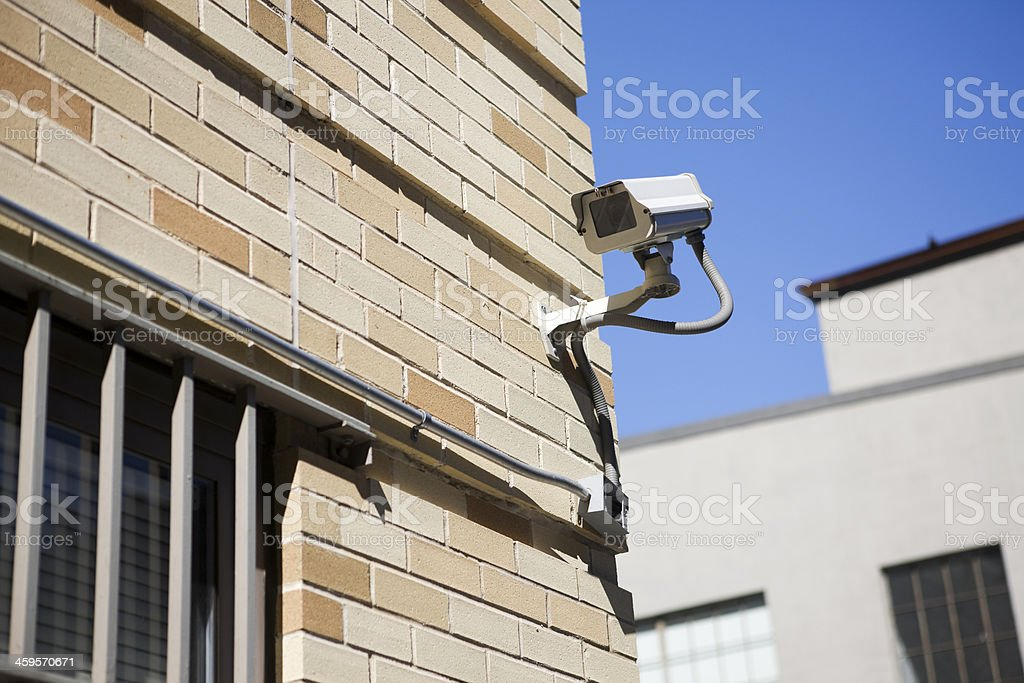 Brick Building with Security Camera Outside, Low Angle, Copy Space royalty-free stock photo