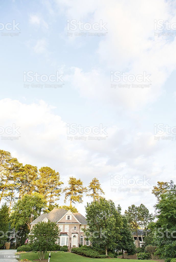 Brick Home Under Pleasant Skies royalty-free stock photo