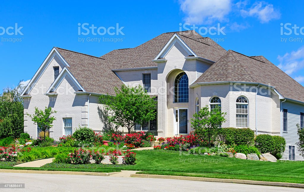 Brick home with beautiful landscaping stock photo