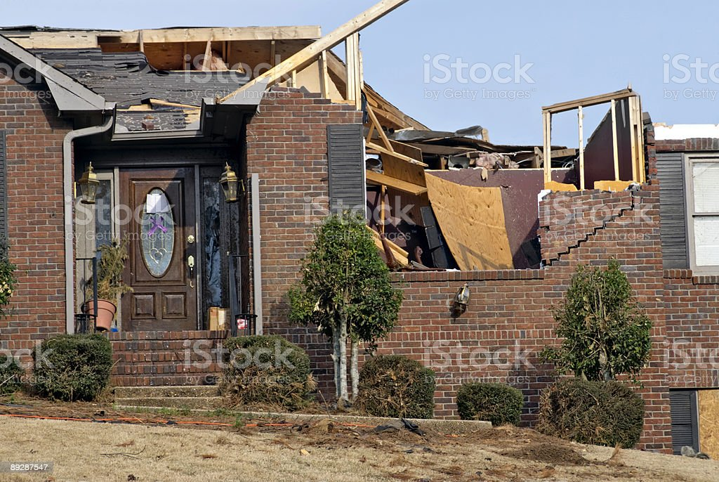 Brick house with the roof destroyed by an EF2 tornado stock photo