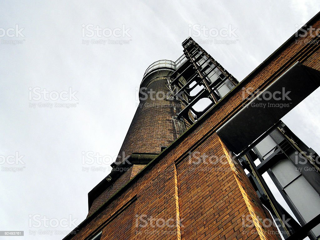 Brick industrial tower and smokestack royalty-free stock photo