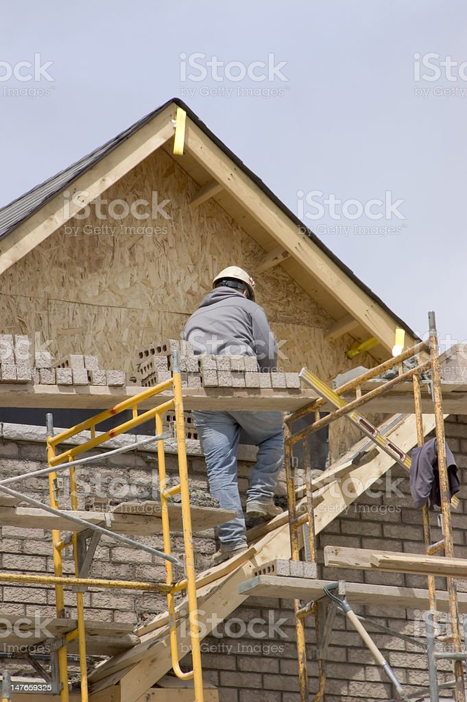 Brick Layer and New Home Construction royalty-free stock photo