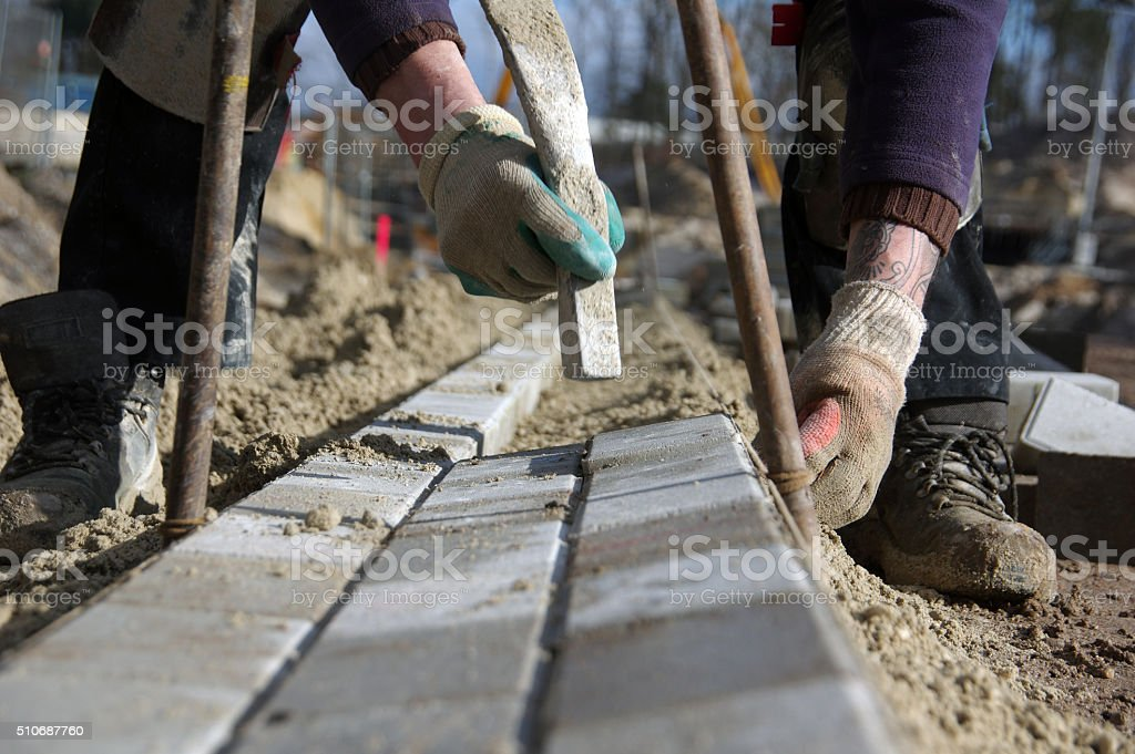 Brick layer in action stock photo